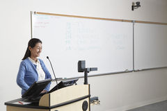 Female Professor Standing At Podium Stock Photos