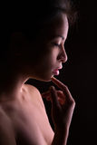 Female profile on black Royalty Free Stock Photo