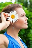 Female profile with flower Stock Photography