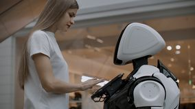 A female programmer tests the robot for the ability to interact with users. The use of a robot assistant in the office
