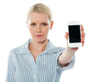 Female promoting iphone. Corporate female promoting iphone against white background Royalty Free Stock Photo