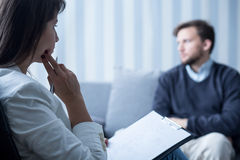 Female psychiatrist talking with patient Stock Images