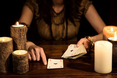 Female psychic is telling the future with cards, concept tarot a. Female psychic is telling the future with playing cards, concept tarot and numerology stock image