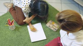 Female psychologist conducts diagnostics for teenage girl, projective drawing method. Back to school, learning problems stock video footage