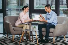 Psychologist giving napkin to upset businessman royalty free stock images