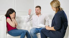 Female psychologist helping worried young couple. royalty free stock photography