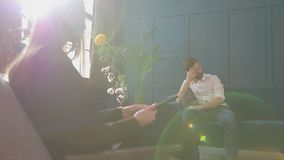 Female psychologist listening to the man client sitting during psychological session in the blue office interior. Female psychologist listening to the man stock footage