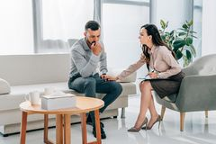 female psychologist and patient having consultation stock photography