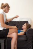 Female psychotherapist hypnotize a female patient. A sexy female psychotherapist treats a teenage female patient with normal and cliche ways Royalty Free Stock Images