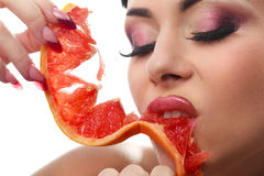 Female with pummelo slice Stock Photography