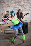 Female punk rock band. Young all girl punk rock band performs in a warehouse Stock Photography