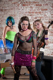 Female Punk Rock Band. Young all girl punk rock band performs in a warehouse Royalty Free Stock Photo