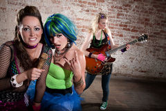 Female punk rock band. Young all girl punk rock band performing Royalty Free Stock Image