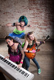 Female punk rock band. Young all girl punk rock band performing Stock Photo