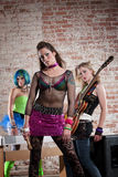 Female punk rock band. Young all girl punk rock band performs in a warehouse Stock Image