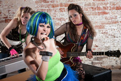 Female punk rock band. Young all girl punk rock band performs in a warehouse Stock Images