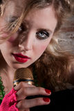 Female punk rocker. Close up of a young female punk rocker singing Stock Images