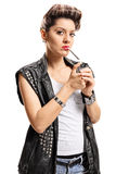 Female punker lighting up a joint with a lighter. Isolated on white background royalty free stock photo