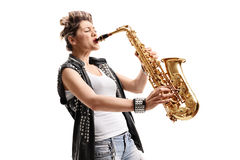 Female punker playing a saxophone. Isolated on white background stock photography