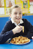 Female Pupil Eating Unhealthy School Lunch Royalty Free Stock Photo