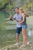 Female pupil learning to fish Royalty Free Stock Images