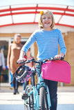 Female Pupil Pushing Bike At End Of School Day Stock Images