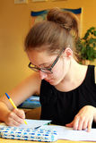 Female Pupil Writing Royalty Free Stock Photo