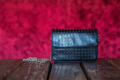 Female Purse on red velvet background royalty free stock images