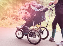 Female pushing stroller Royalty Free Stock Photography
