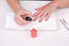 Female putiing nail polish Stock Photo