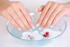 Female putting her beautiful fingers into water Stock Photos