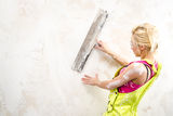 Female with putty knife working Royalty Free Stock Image