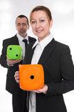 Female quota. Female and men holding each one a die Stock Image