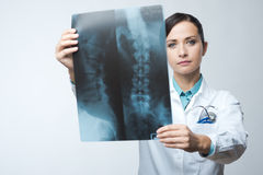 Female radiologist checking x-ray image Stock Photography