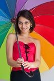 Female with rainbow umbrella Stock Photography