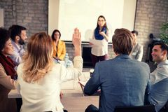 Female raises hand for discussion royalty free stock images