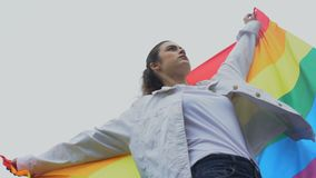 Female raises rainbow flag, solidarity with same-sex marriage, lgbt rights. Stock footage stock video