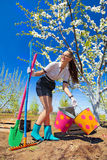 Female with rakes and spade Royalty Free Stock Photos
