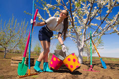 Female with rakes and spade Stock Photography