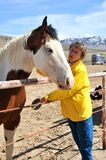 Female Rancher And Horse Bonding. Royalty Free Stock Photos