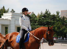 Female Ranger. Patrolling on Renmin Square Dalian, China Royalty Free Stock Image