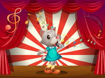 A female rat performing at the stage Stock Image