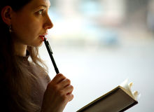 Female reading a book Stock Images