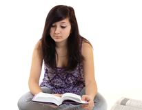 Female reading book Stock Image