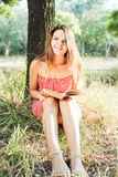 Female reading book in park. Young beautiful caucasian female reading book in park Royalty Free Stock Photo
