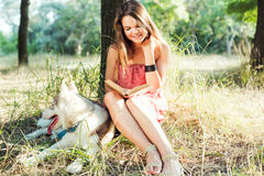 Female reading book in park. Young beautiful caucasian female reading book in park Stock Photo
