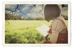 Female reading book under tree Royalty Free Stock Photo