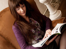 Female reading a magazine at tea time Royalty Free Stock Photos
