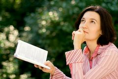 Female reading in park Royalty Free Stock Image