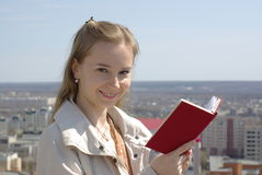 Female reading a red book Stock Photo